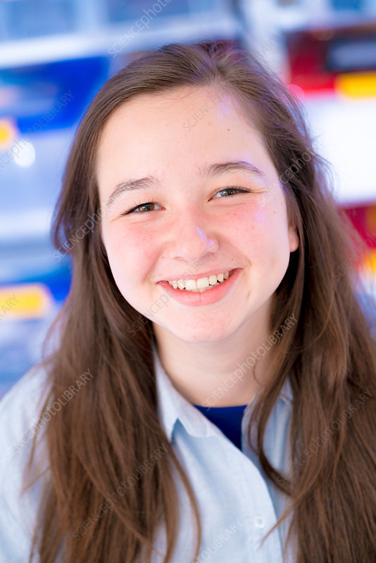 Portrait of girl with long brown hair, smiling