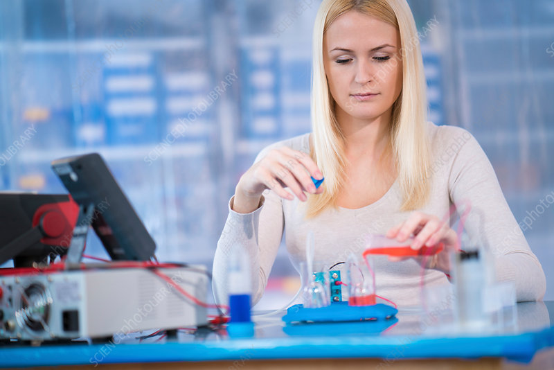 Woman experimenting with fuel cell