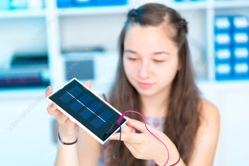 Girl working on solar cell in classroom
