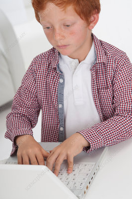 Boy using laptop computer
