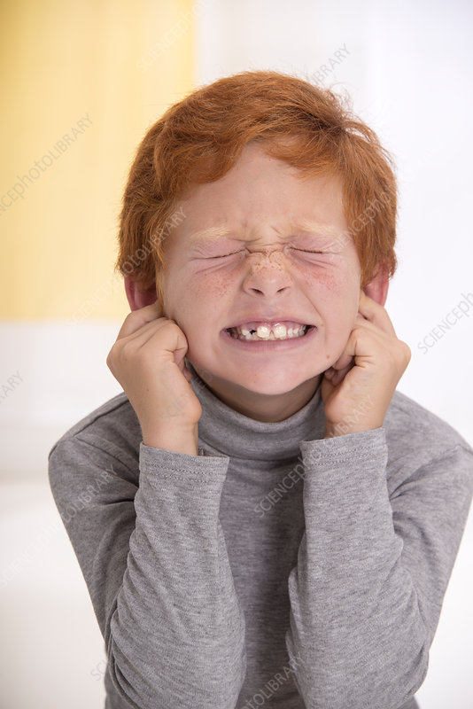 Boy with fingers in his ears