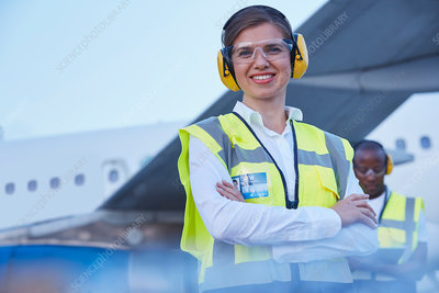 Portrait smiling female air traffic controller