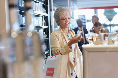 Smiling woman shopping for perfume