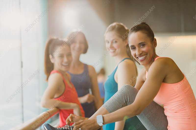 Portrait smiling women in gym studio
