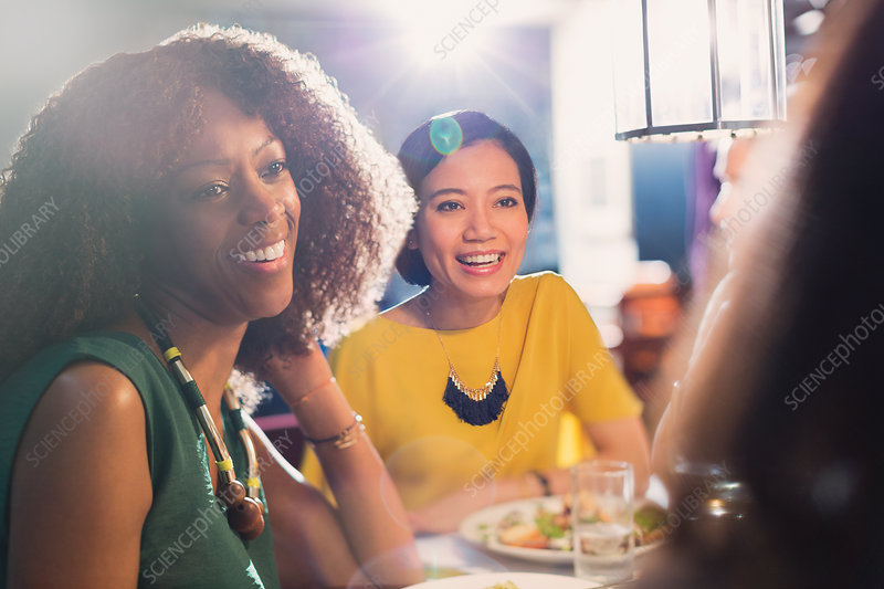 Women friends talking and dining