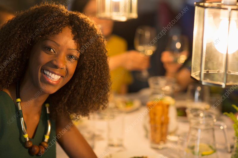 Portrait smiling woman dining with friends
