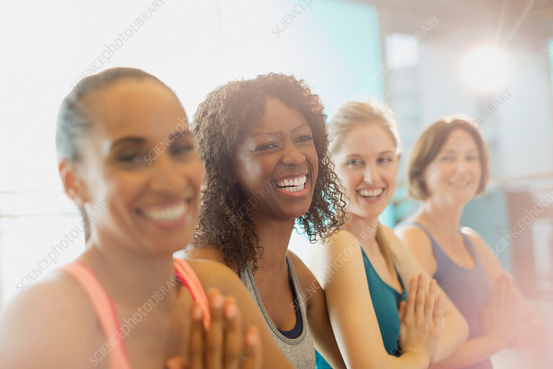 Portrait enthusiastic women in yoga class