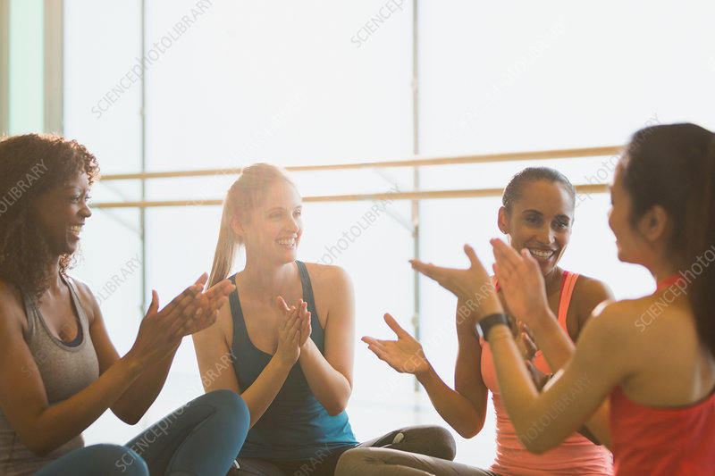Smiling women in exercise class gym studio