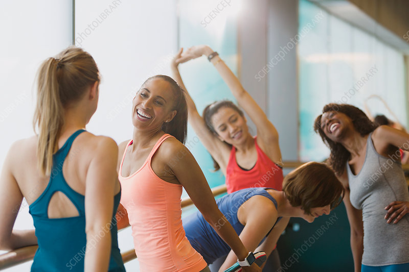 Smiling women talking and stretching