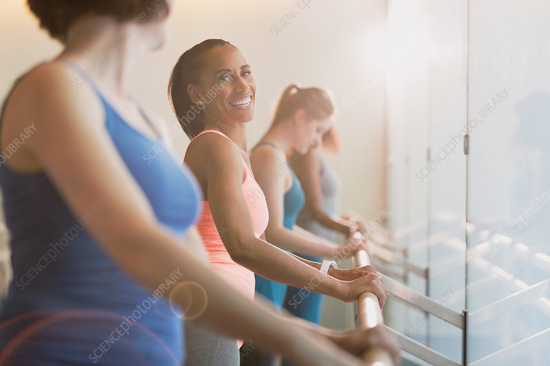 Smiling women at barre