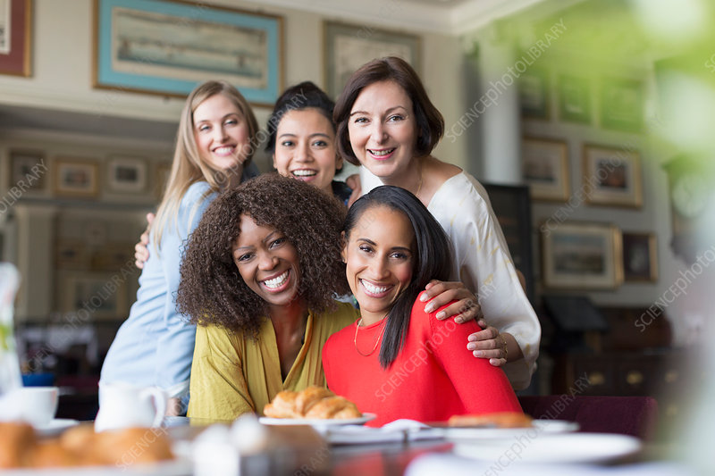 Portrait smiling women friends dining
