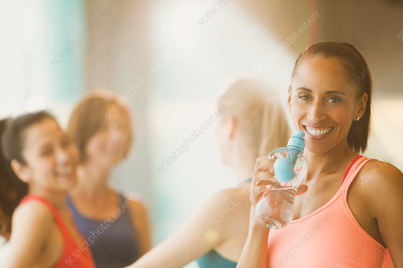 Portrait smiling woman drinking water