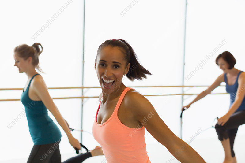 Portrait enthusiastic woman jumping rope