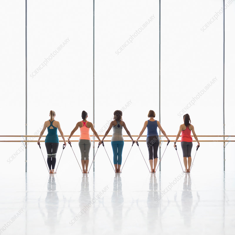 Women exercising in exercise class gym studio