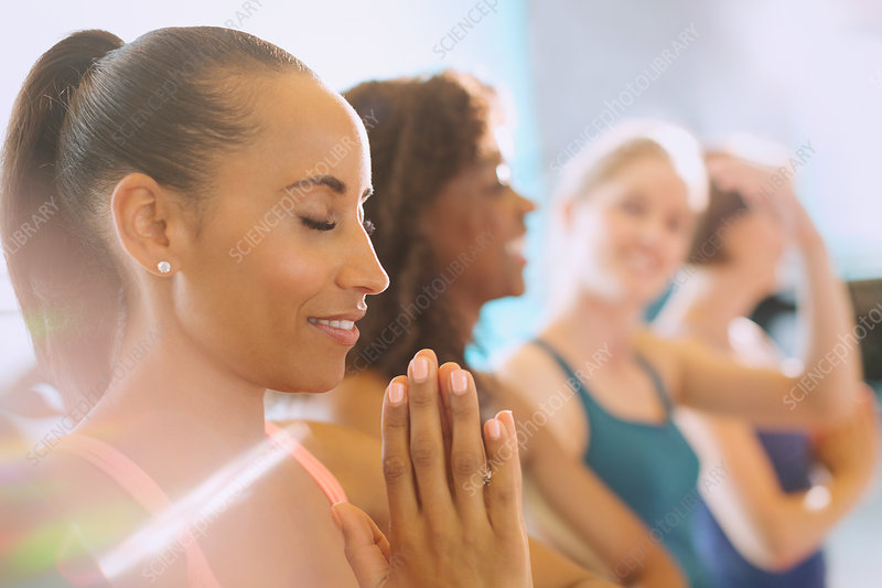 Serene woman practicing yoga with hands