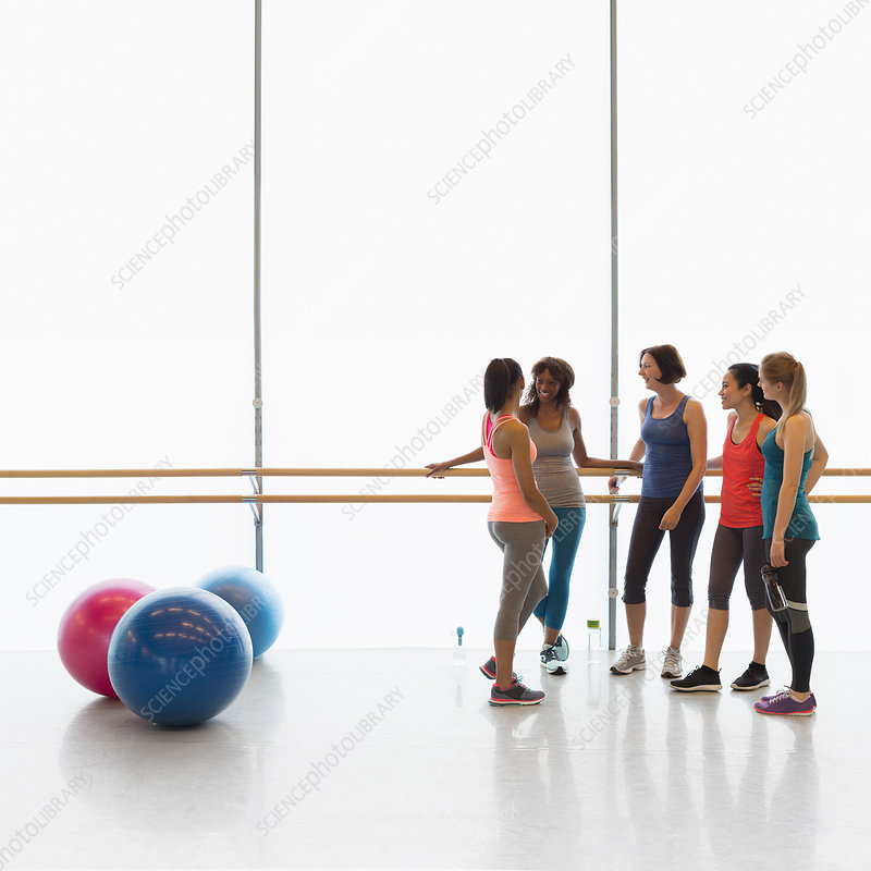 Women talking at barre