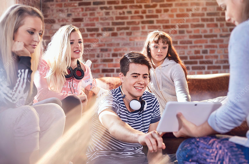 Young adult dancers with headphones