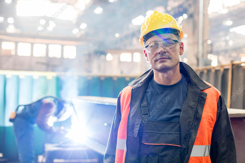 Portrait confident steel worker in factory