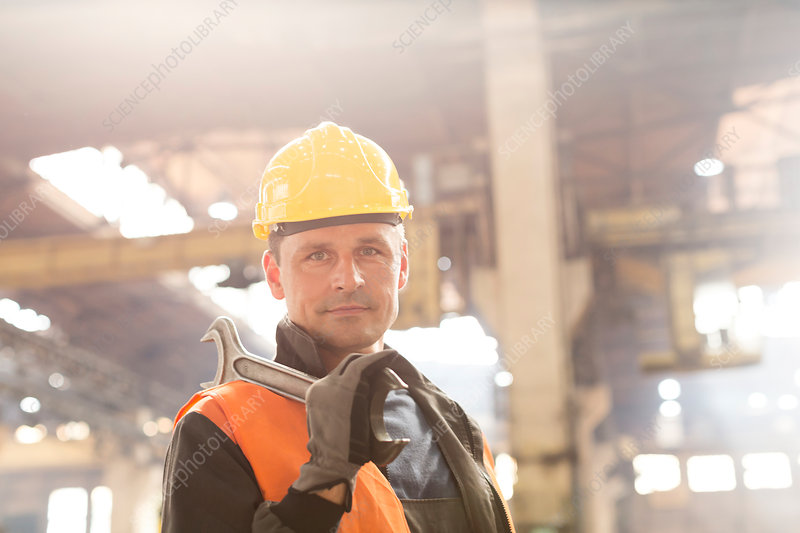 Steel worker holding large wrench