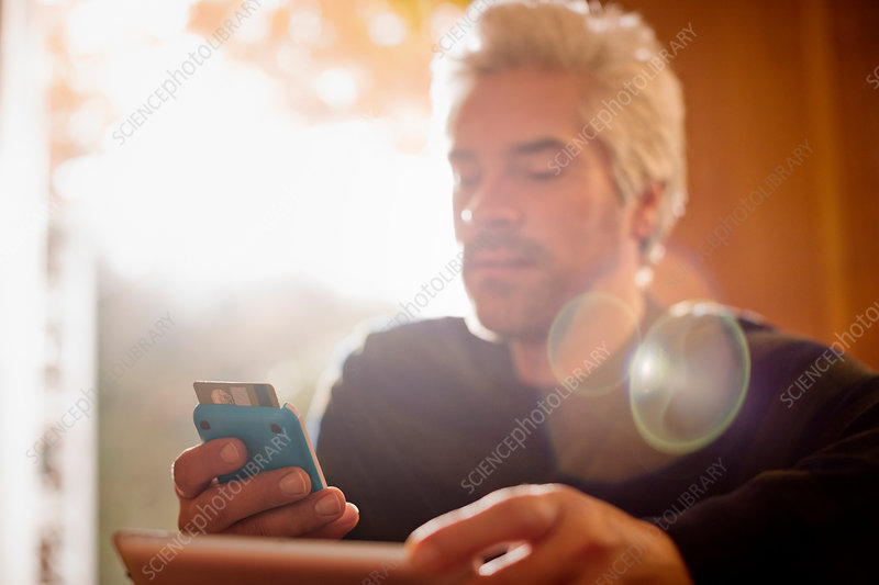 Man with credit card and smart phone