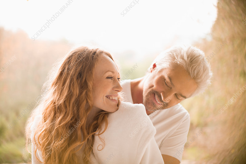 Affectionate playful couple smiling