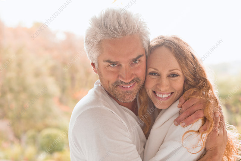 Portrait smiling couple hugging outdoors