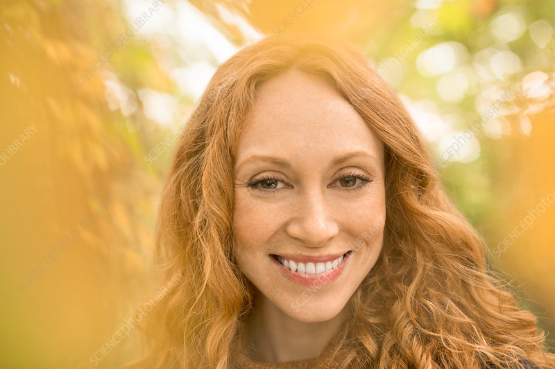 Close up portrait smiling woman with red hair
