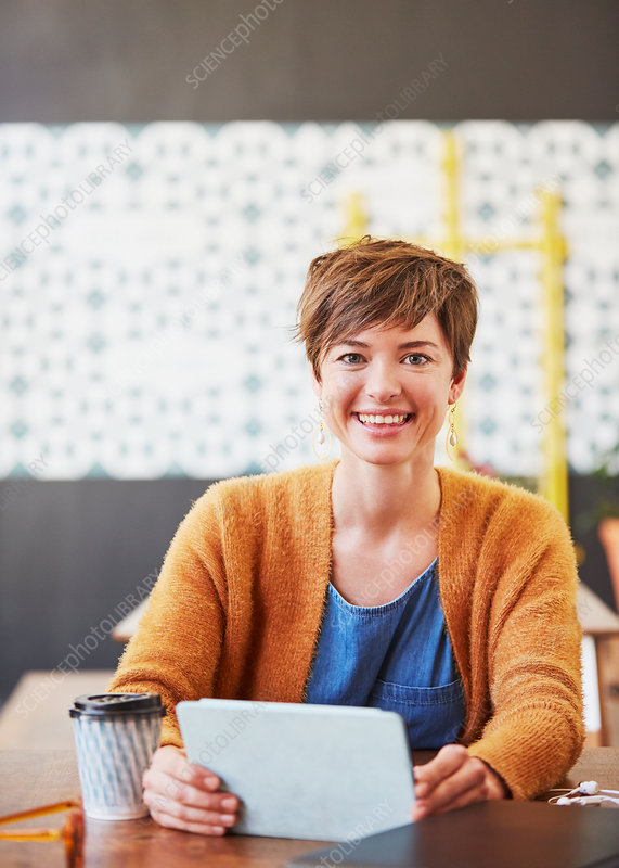 Portrait smiling businesswoman drinking coffee