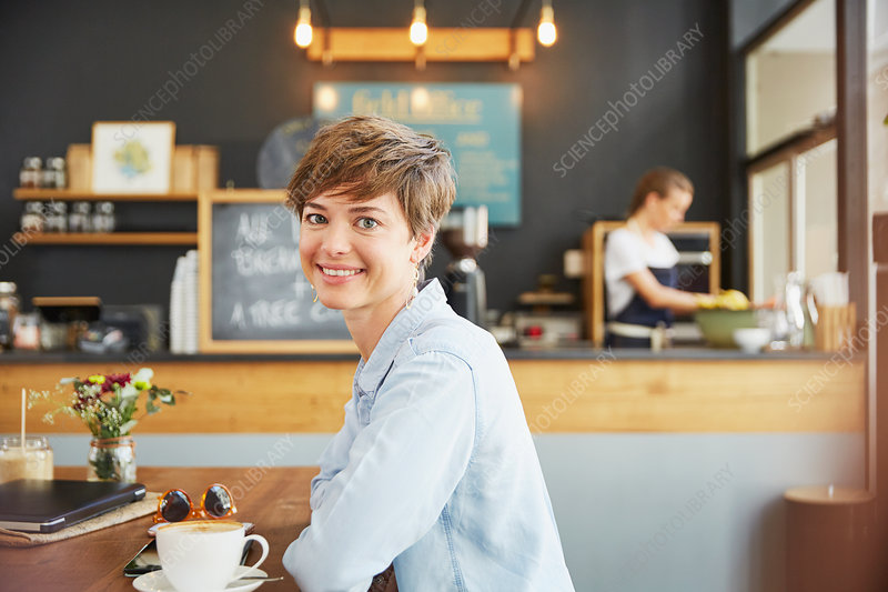 Portrait smiling woman drinking coffee