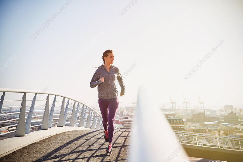 Female runner running at sunrise