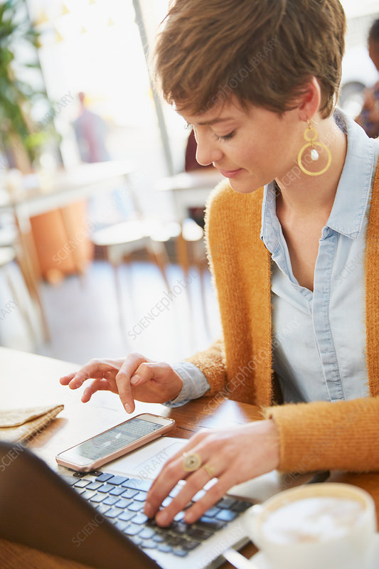 Businesswoman working using smart phone and laptop