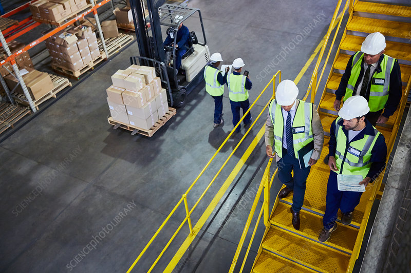 Forklift, managers and workers