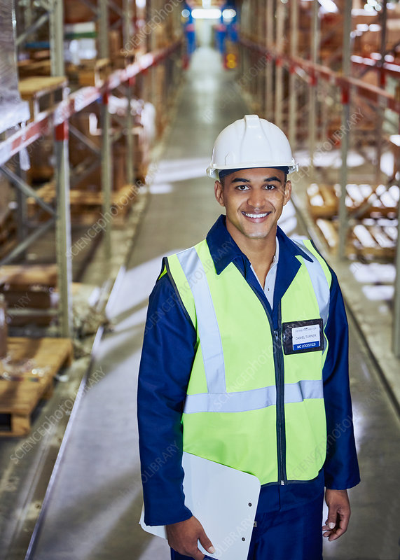 Portrait smiling worker with clipboard aisle