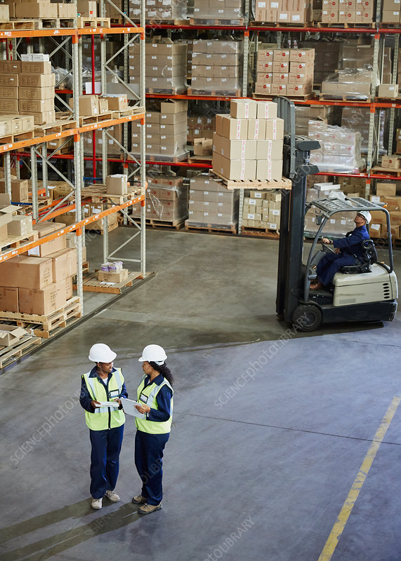 Forklift and workers meeting