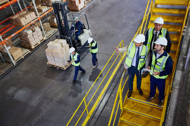 Forklift, managers and workers talking