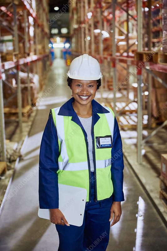 Portrait smiling female worker aisle
