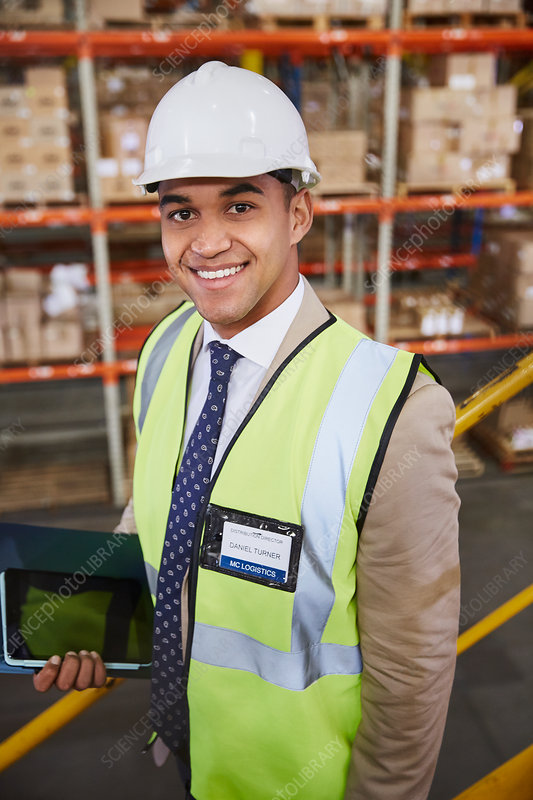 Portrait smiling manager in distribution warehouse