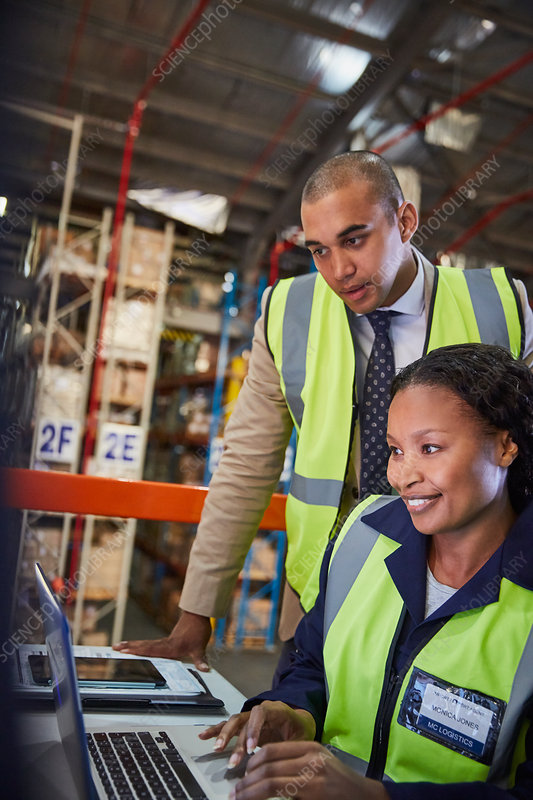 Manager and worker in distribution warehouse