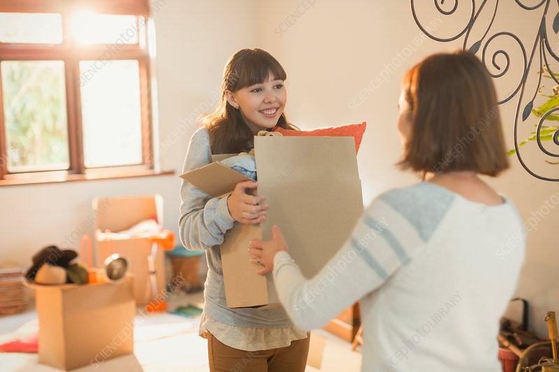 Mother helping daughter move into new apartment