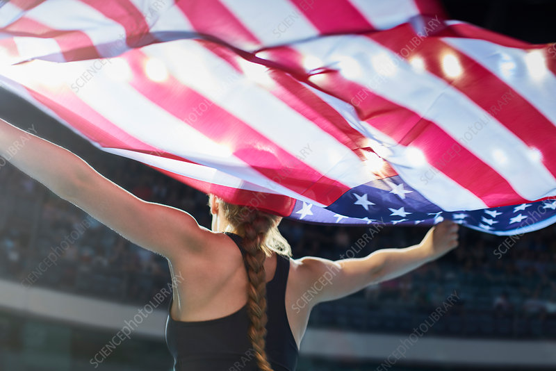 Female athlete with American flag
