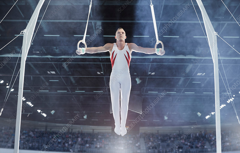 Male gymnast balancing on gymnastics rings