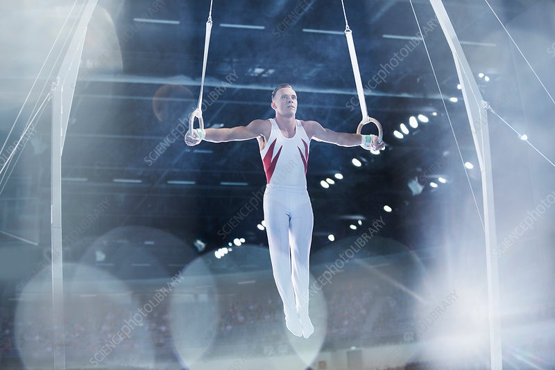 Male gymnast performing on gymnastics rings