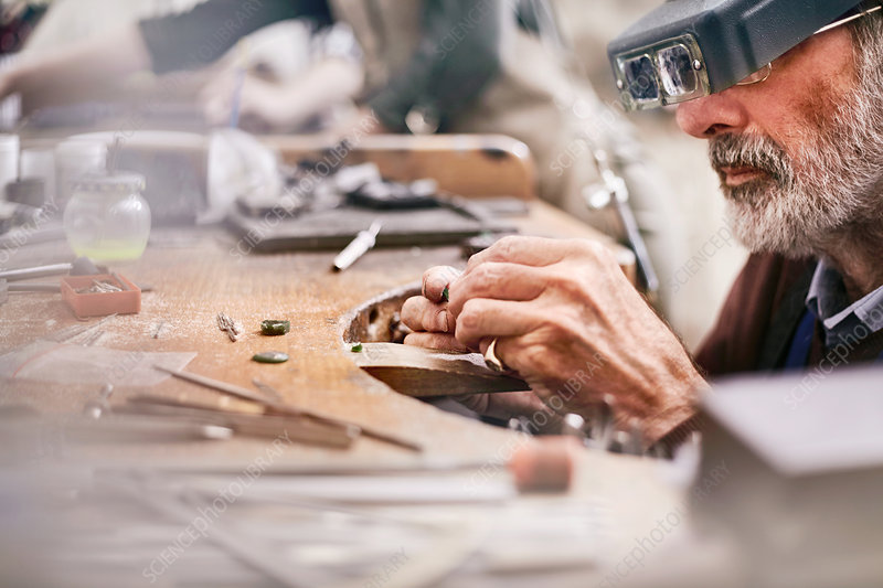 Male jeweller making jewellery