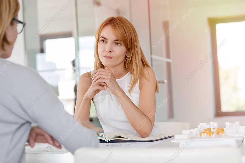 Businesswoman listening to colleague in meeting