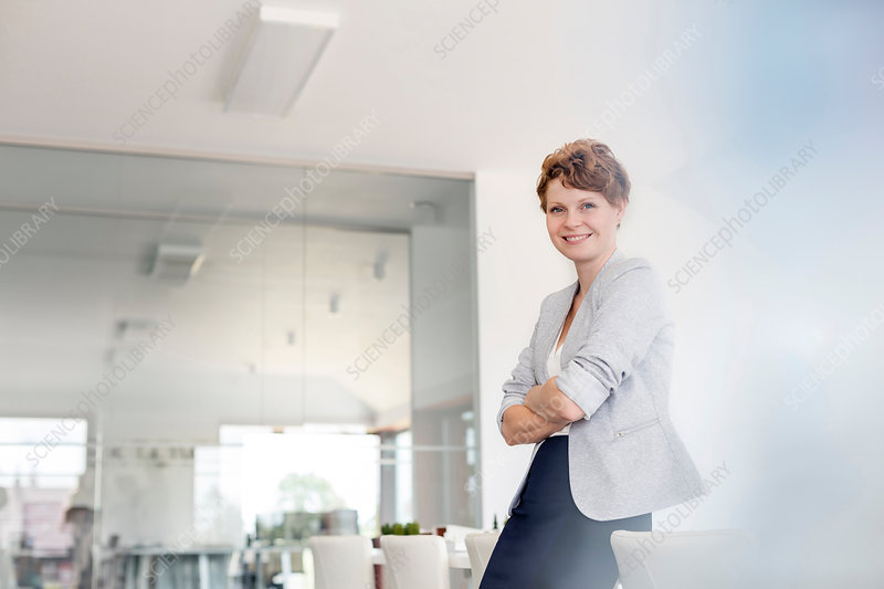 Portrait smiling businesswoman in conference room