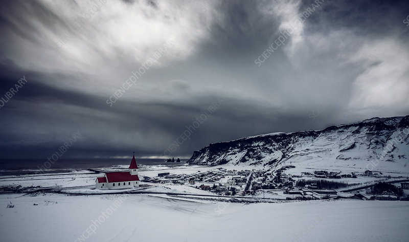 Church in snow covered landscape, Vik, Iceland