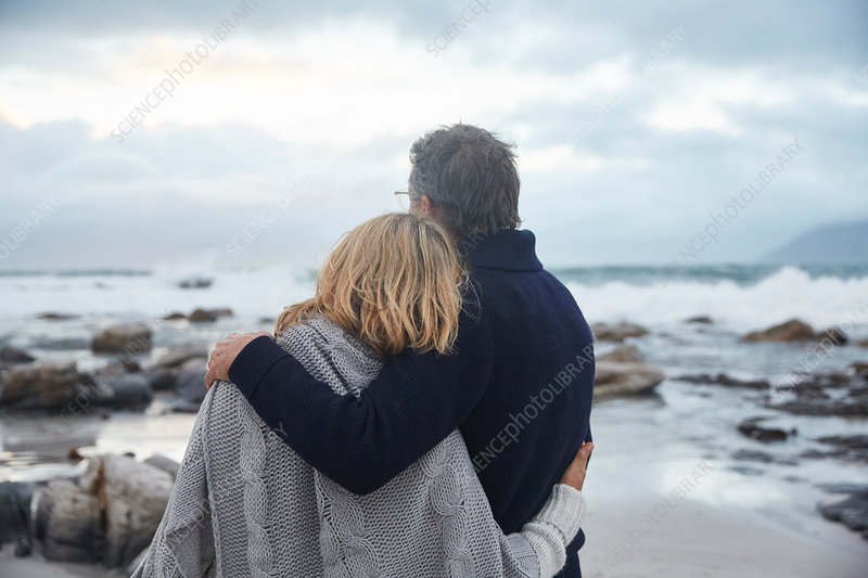 Serene couple hugging on winter beach