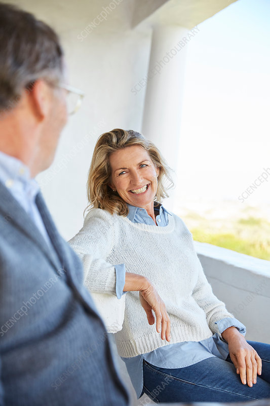 Smiling senior couple talking on patio