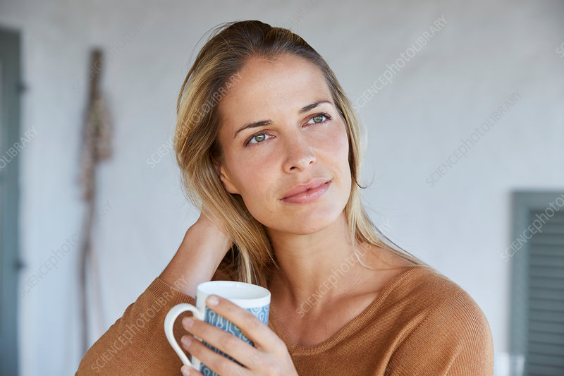 Serene woman drinking coffee