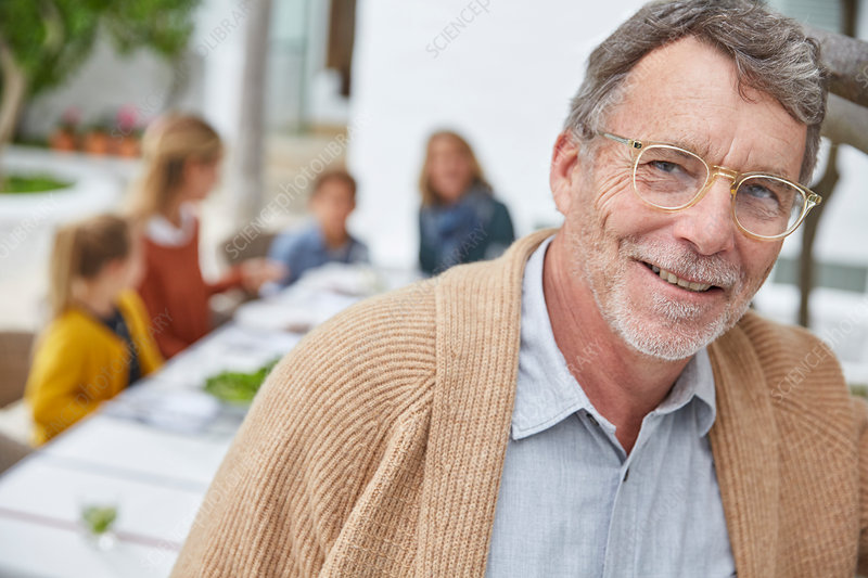 Senior man enjoying patio lunch with family